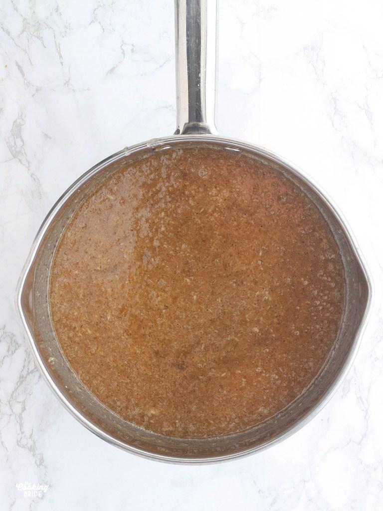 Jezebel sauce ingredients combined in a steel saucepan