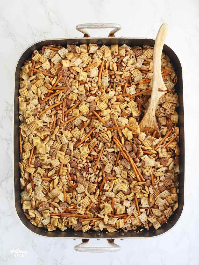 Chex mix ingredients in a large roasting pan