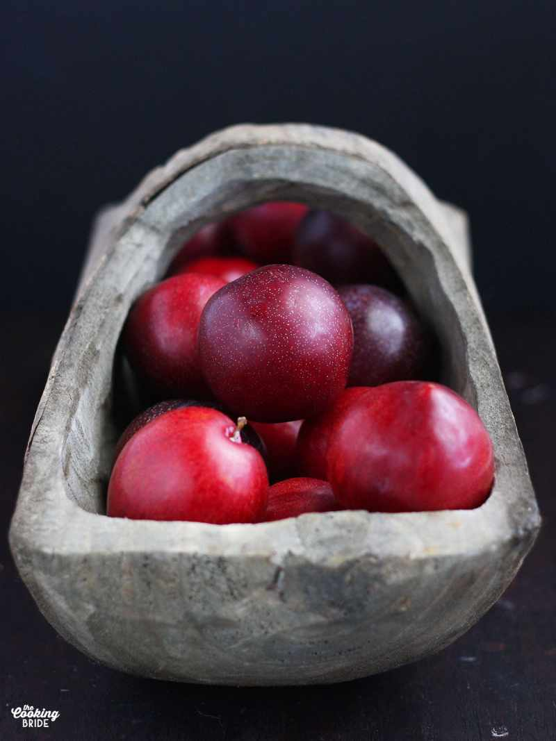 wooden basket full of plums