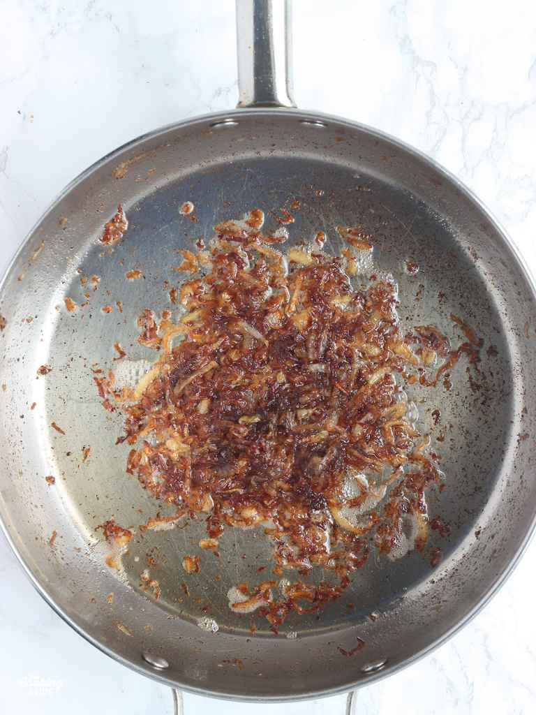 caramelized onions in a stainless steel skillet