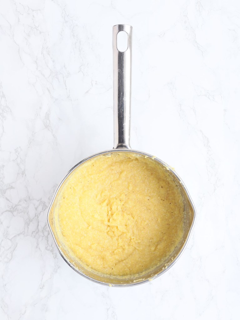cooked grits in a saucepan