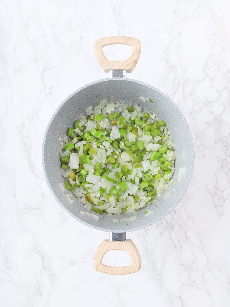 gray pot with diced bell peppers, onions and celery