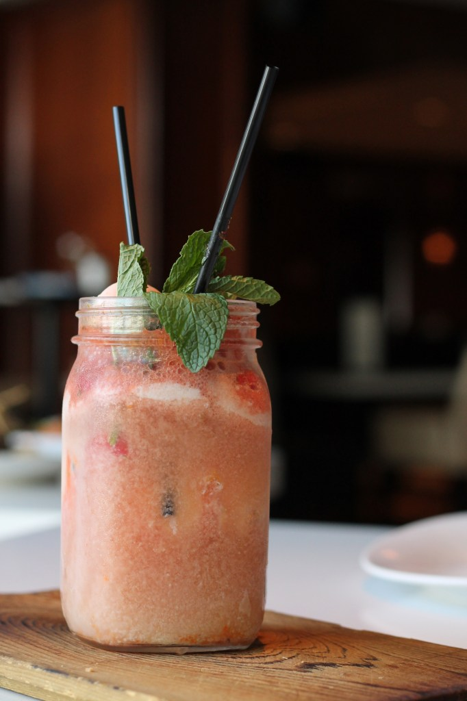 """What says """"summer"""" more than an ice cream float?? This one is rhubarb, garnished with a macaron. Perfect for sipping with your sweetie."""