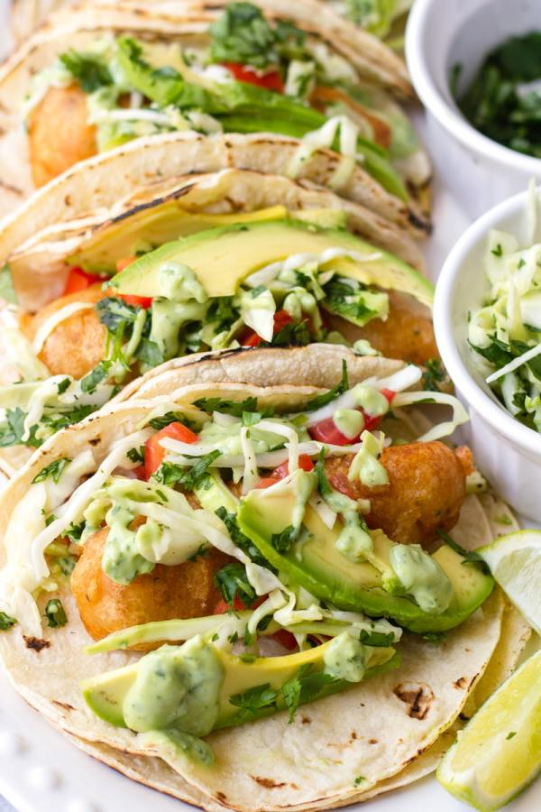 baja fish tacos with avocado and toppings