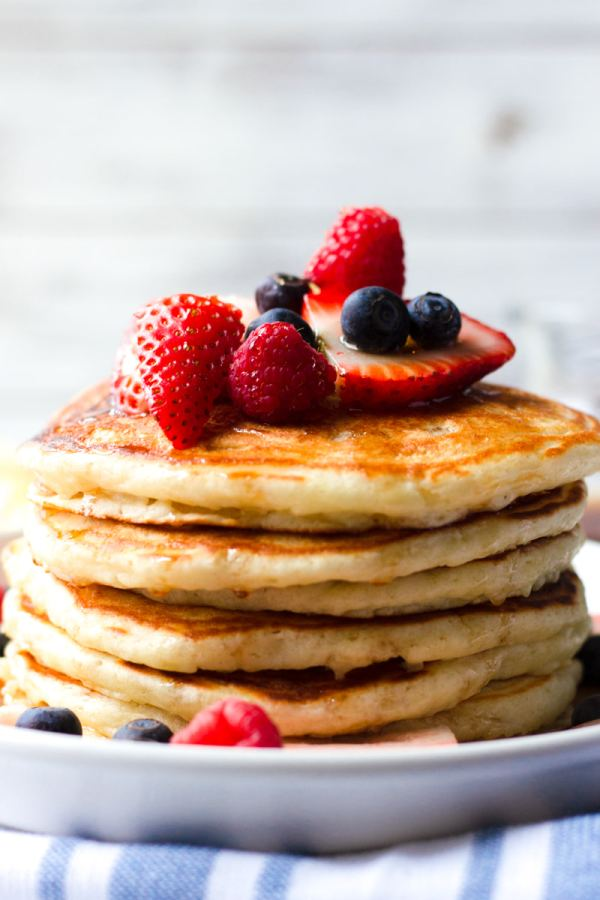fluffy buttermilk pancakes with mixed berry topping