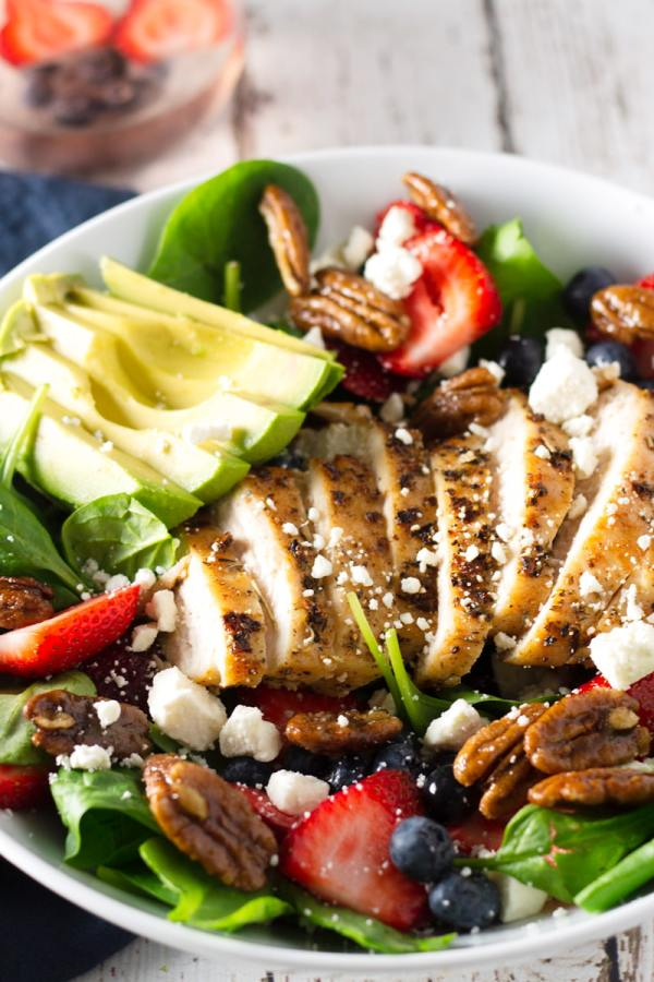 berry, spinach, and avocado salad with grilled herbed chicken