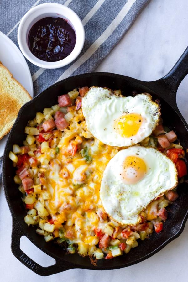 American Potato Skillet with Two Fried Eggs for Breakfast