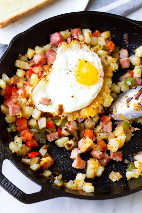 Country Style Potatoes with Ham and Bell Peppers on Cast Iron Skillet