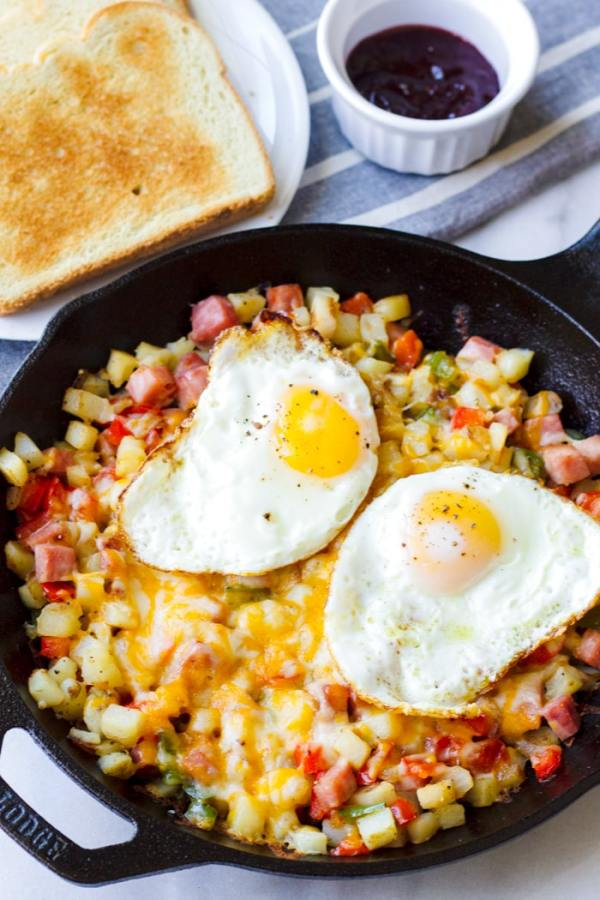 Cast Iron Skillet with Potatoes, Ham, Bell Peppers, Cheese, Egg