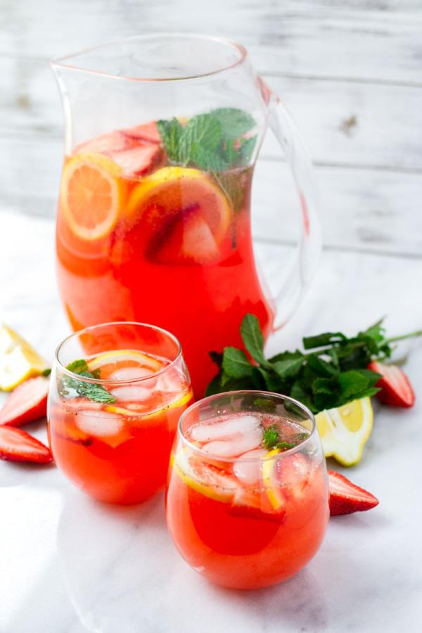 Two Glasses of Strawberry Lemonade with Lemon Slices