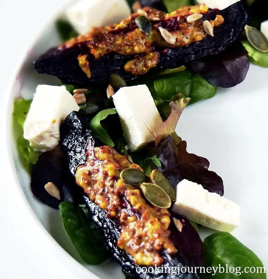 roast beetroot salad on a white plate