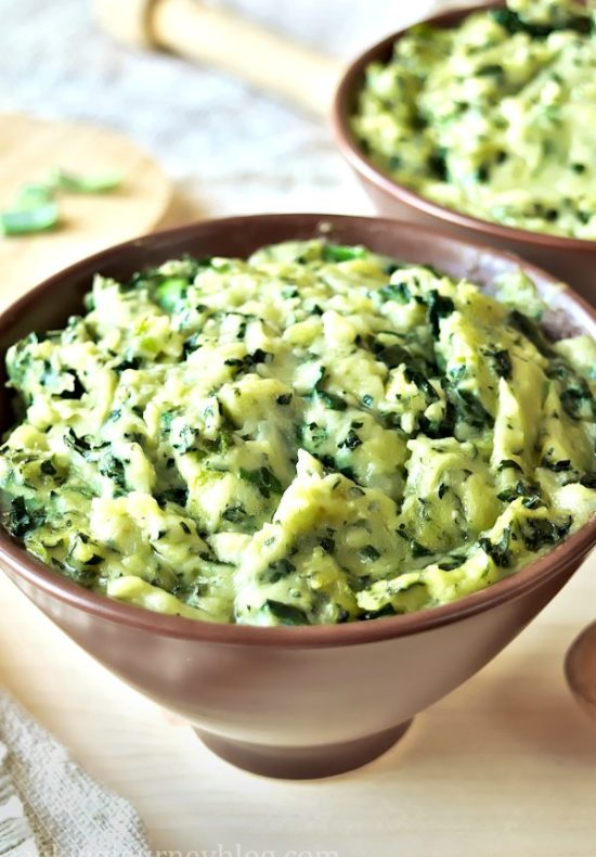 Colcannon - mashed potatoes in a bowl with wooden spoon