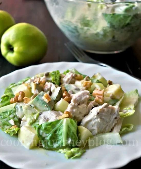 Avocado chicken salad, served on a white plate