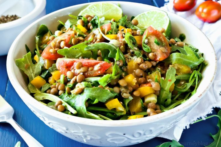 Lentil salad in a bowl on a blue table