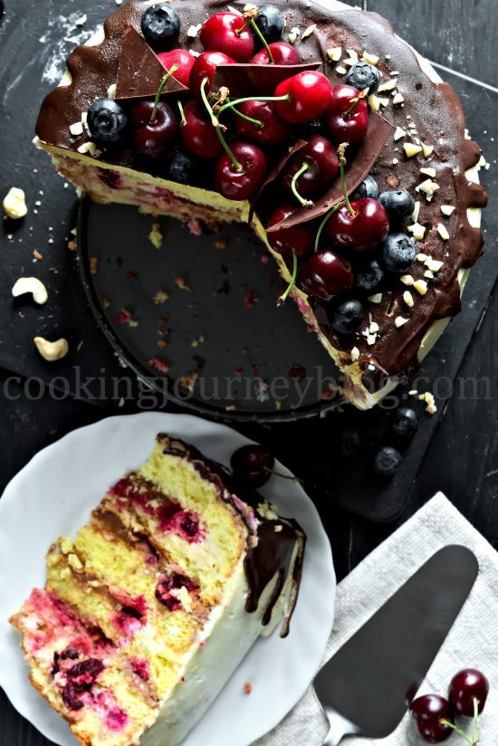 Chocolate Cherry Layer Cake (Birthday Cake), cut, multiple layers on a plate