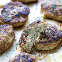 Oven Baked Turkey Zucchini Burgers Recipe. Golden brown, made with grated zucchini. Topped with chopped dill.