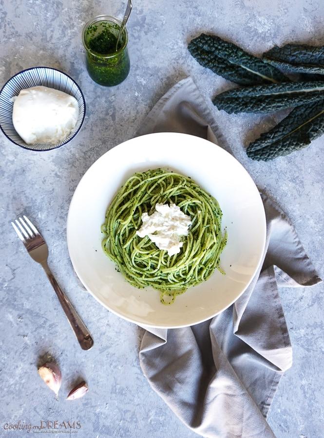 overhead shot with spaghetti with cavolo nero pesto and burrata