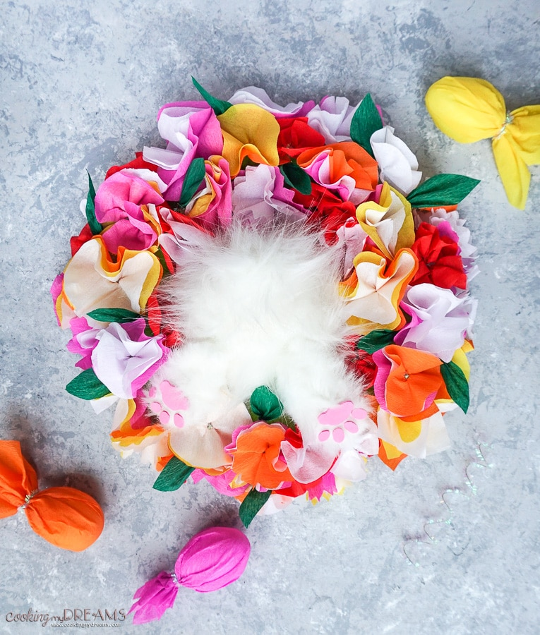overhead shot of easter centerpiece with paper flowers and fluffy bunny