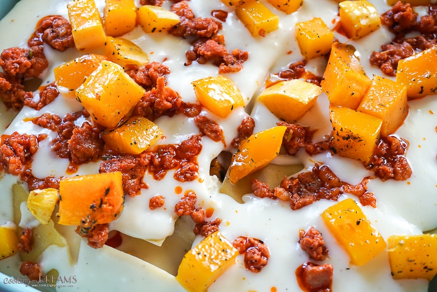 close up of raw lasagna with butternut squash and sausage