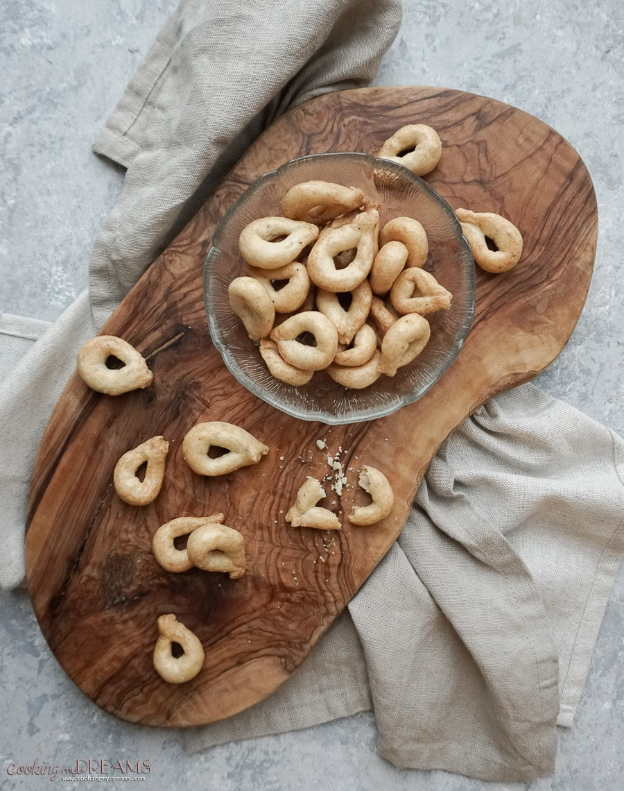 cutting board with tarallini and a little bowl