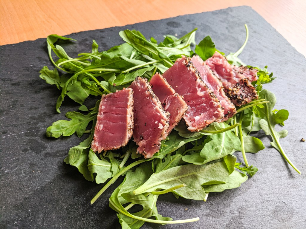 Peppercorn Crusted Seared Ahi on a bed of Arugula