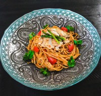 Trenette pasta with sauteed chicken and tomato sauce