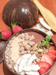 chocolate banana smoothie bowl with fresh fruits and seeds