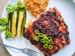 salmon with black bean sauce and a side of soy marinated cucumber and pickled veggies