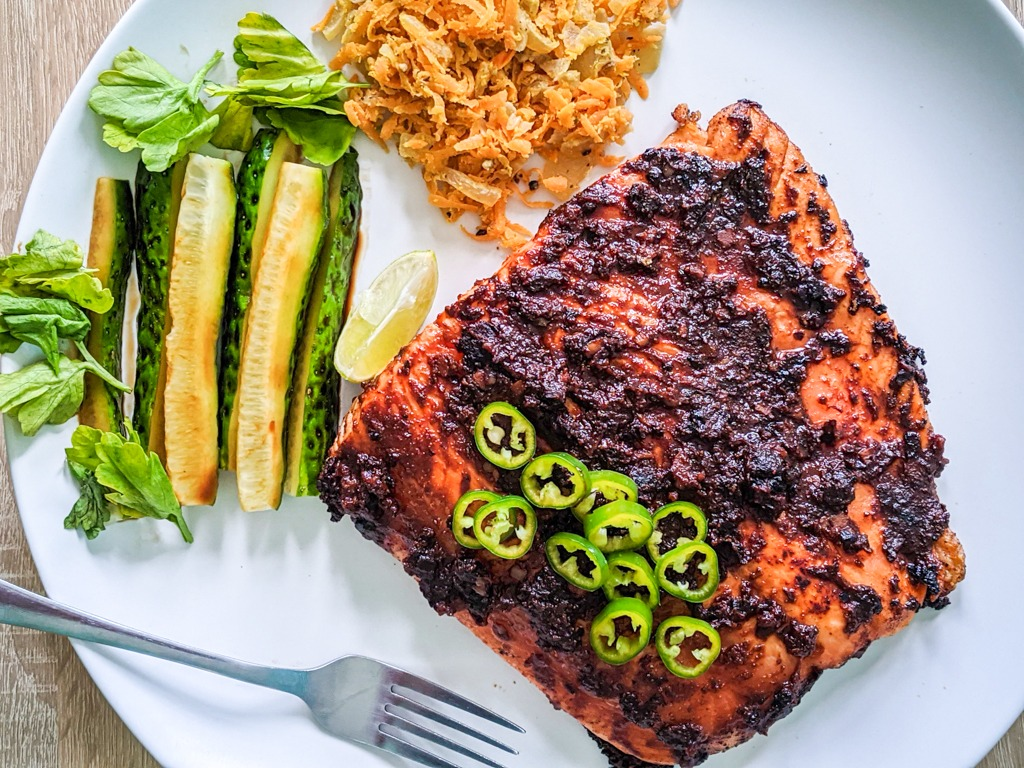 Black Bean Salmon with a side of soy marinated cucumber and pickled carrot.