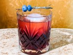 The black latvian cocktail with a base of riga black balsam blackcurrant