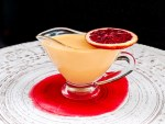blood orange Crème Anglaise in a pouring vessel