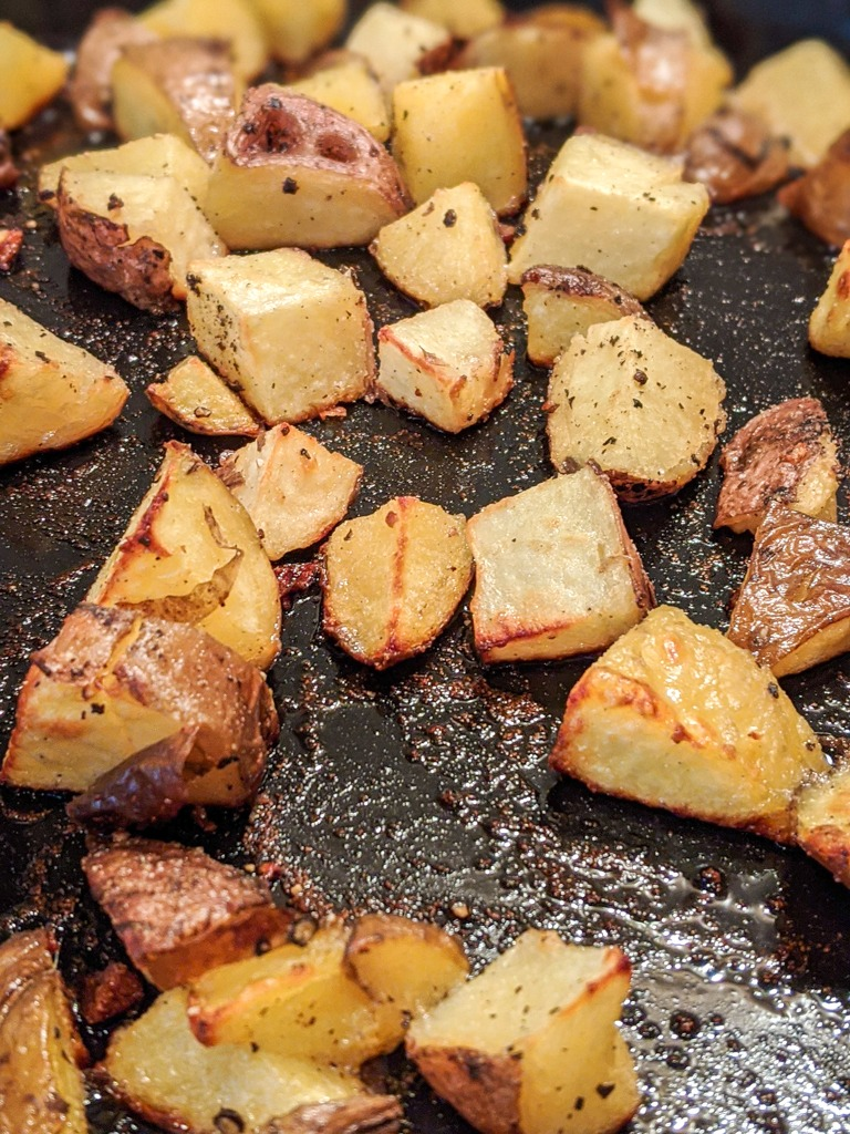 Roasted potatoes ready to be tossed in the red pesto