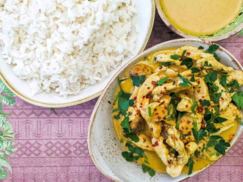Thai Yellow Curry With Chicken. A side of white rice and extra yellow curry sauce