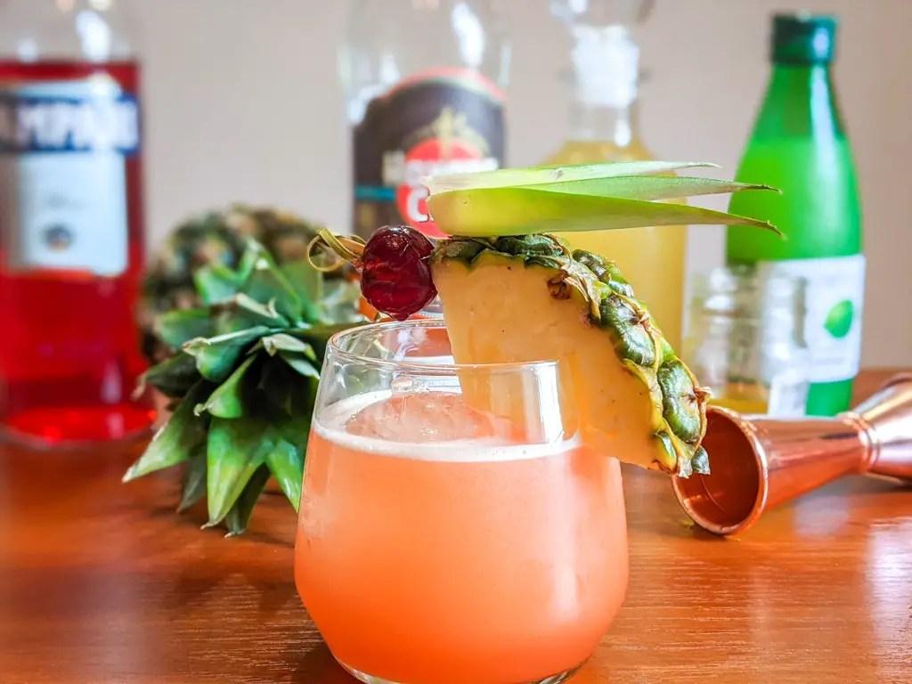 Jungle bird tiki cocktail with traditional garnish