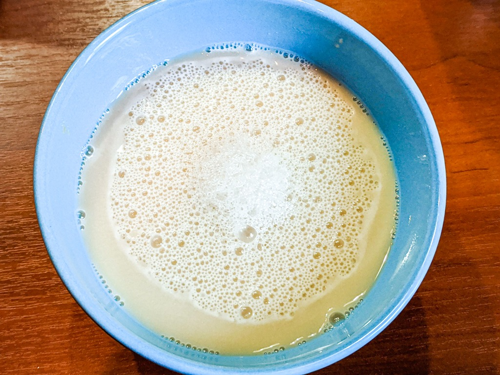 activating the dry yeast in water with sugar