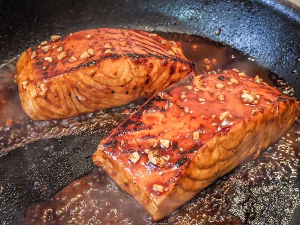 Sriracha seared salmon in pan