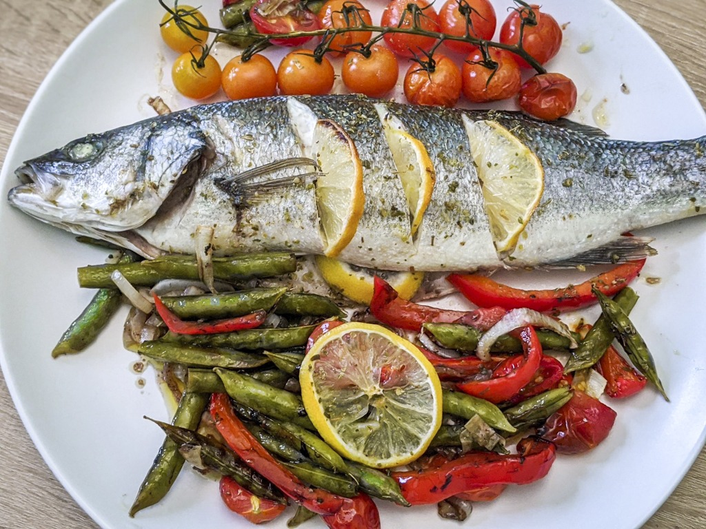 Baked Mediterranean Sea Bass with balsamic roasted vegetables and cherry tomatoes