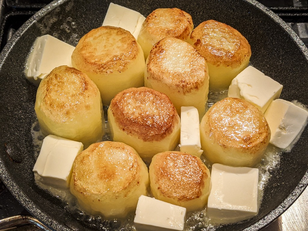 adding heaps of butter to the pan