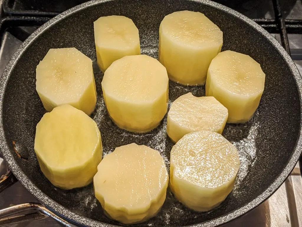 step one of making fondant potatoes