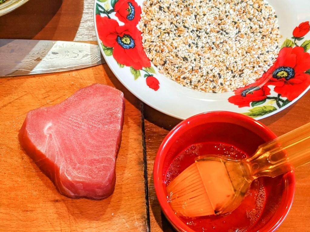 preparing the sesame crusted ahi tuna with an egg white wash