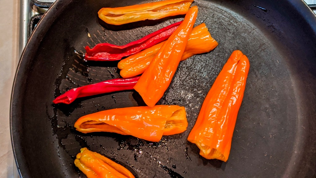 Searing some chili peppers for the adobo