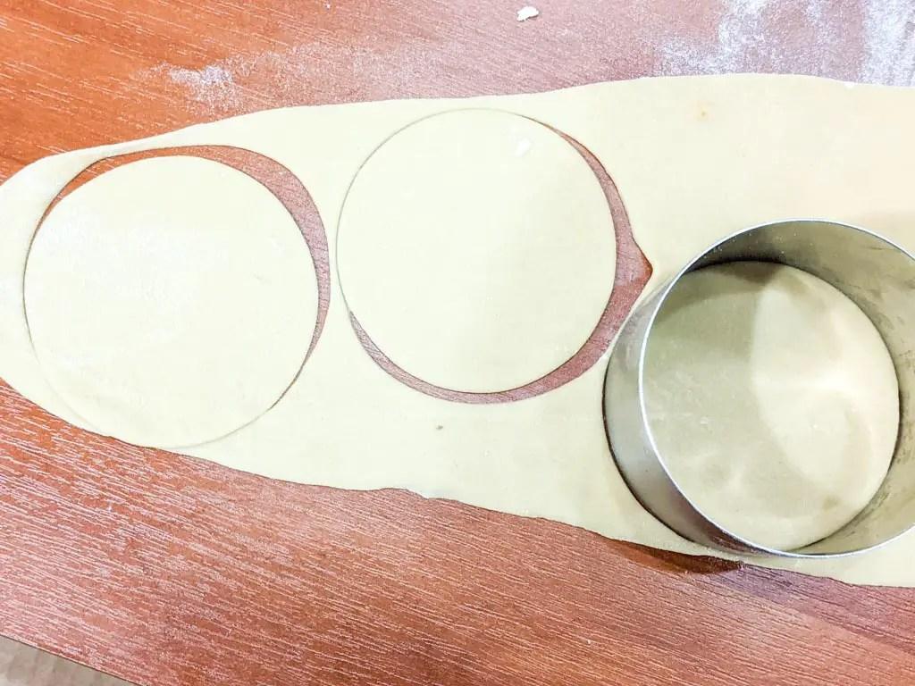 using a ring mold to cut ravioli circles