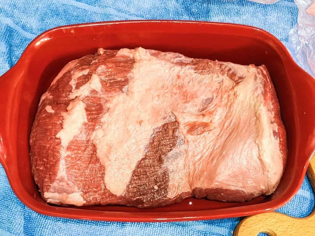 beef brisket in roasting or braising dish
