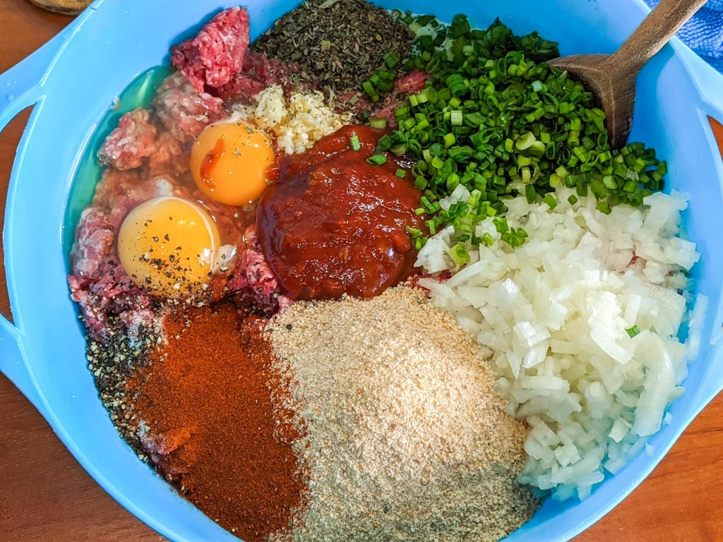 Classic American Meatloaf ingredients in a blue bowl