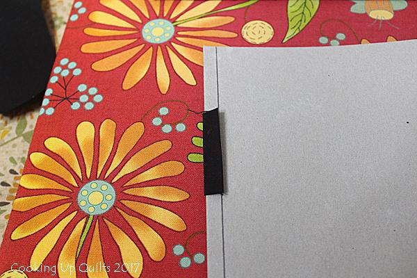 Folded fabric on improvised heat resistant ruler