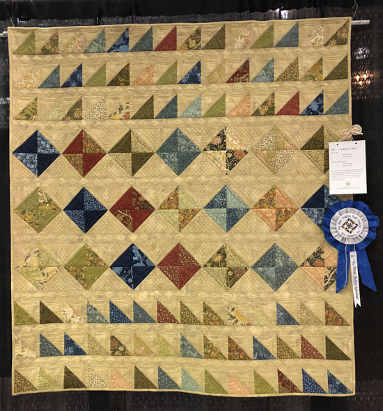 Half square triangle quilt with grunge fabric is a blue ribbon winner
