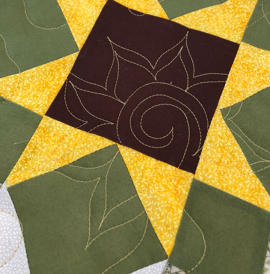 Free hand stitched sunflower quilting motif