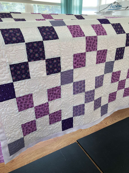 Nine Patch quilt with quilted loopy flowers