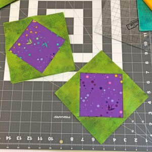 square in a square block with Tula Pink and Alison Glass