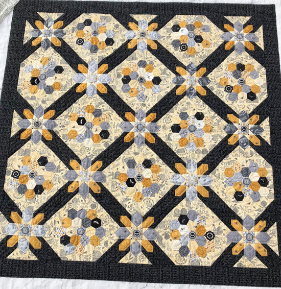 Hexie quilt using bee fabric